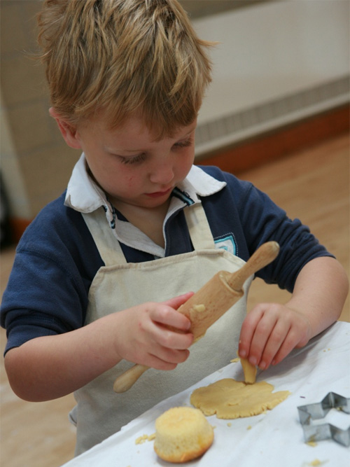 Young boy being creative at Kiddy Cook